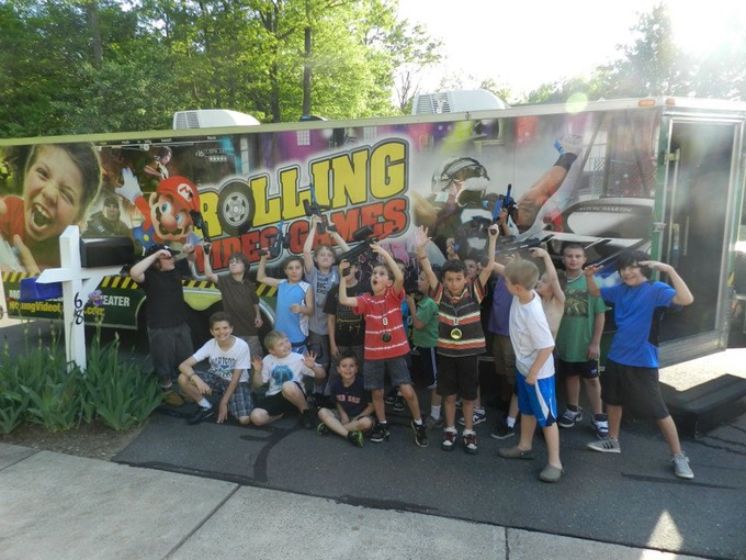 Happy kids birthday party in the Chicagoland video game bus and game truck and trailer