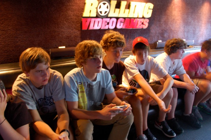 Teens and adults playing video games in the Chicago video game bus and game trailer